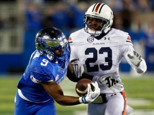 UK receiver Garrett Johnson pulled in a one-handed catch against Auburn.