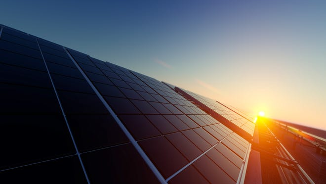Solar panels with sunset in background