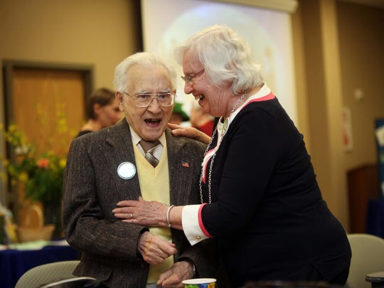 Domenick Cannatelli, a treasurer in 2010-11, shares a laugh with Janet Brown, during a celebration party for the 100th anniversary of the Cooperative Extension.