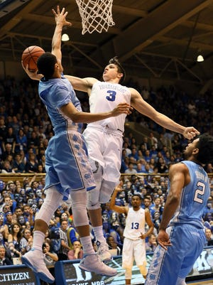 Duke Blue Devils guard Grayson Allen (3) drives to the basket against North Carolina Tar Heels guard Marcus Paige (5) in the second half of their game at Cameron Indoor Stadium.