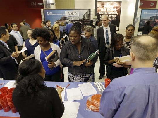 Job seekers attend a job fair in Sunrise, Fla., in