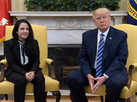 President Donald Trump meets with Aya Hijazi, an Egyptian-American aid worker, in the Oval Office of the White House in Washington on April 21, 2017. Hijazi was freed after nearly three years of detention in Egypt returning to the U.S., Thursday, April 20, 2017.