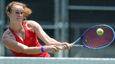 Hannah Bradford returns a serve during practice at William Carey University.