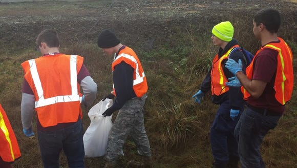 South Kitsap NJROTC cadets pick up trash on the MLK