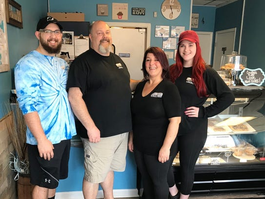 In January, Steve Fahnholz (second from left) and his wife, Natalie Fahnholz (third from left) opened Shore Good Eats 'N' Treats in Neptune City with their son, Stephen. Also pictured is employee Cait Sullivan.