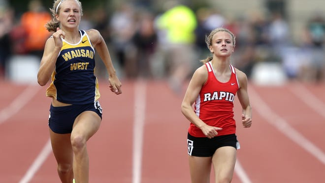 Brooke Jaworski, left, is headed to the USATF Junior Olympics after winning regional titles in both the 200 and 400 meters in her division earlier this month.