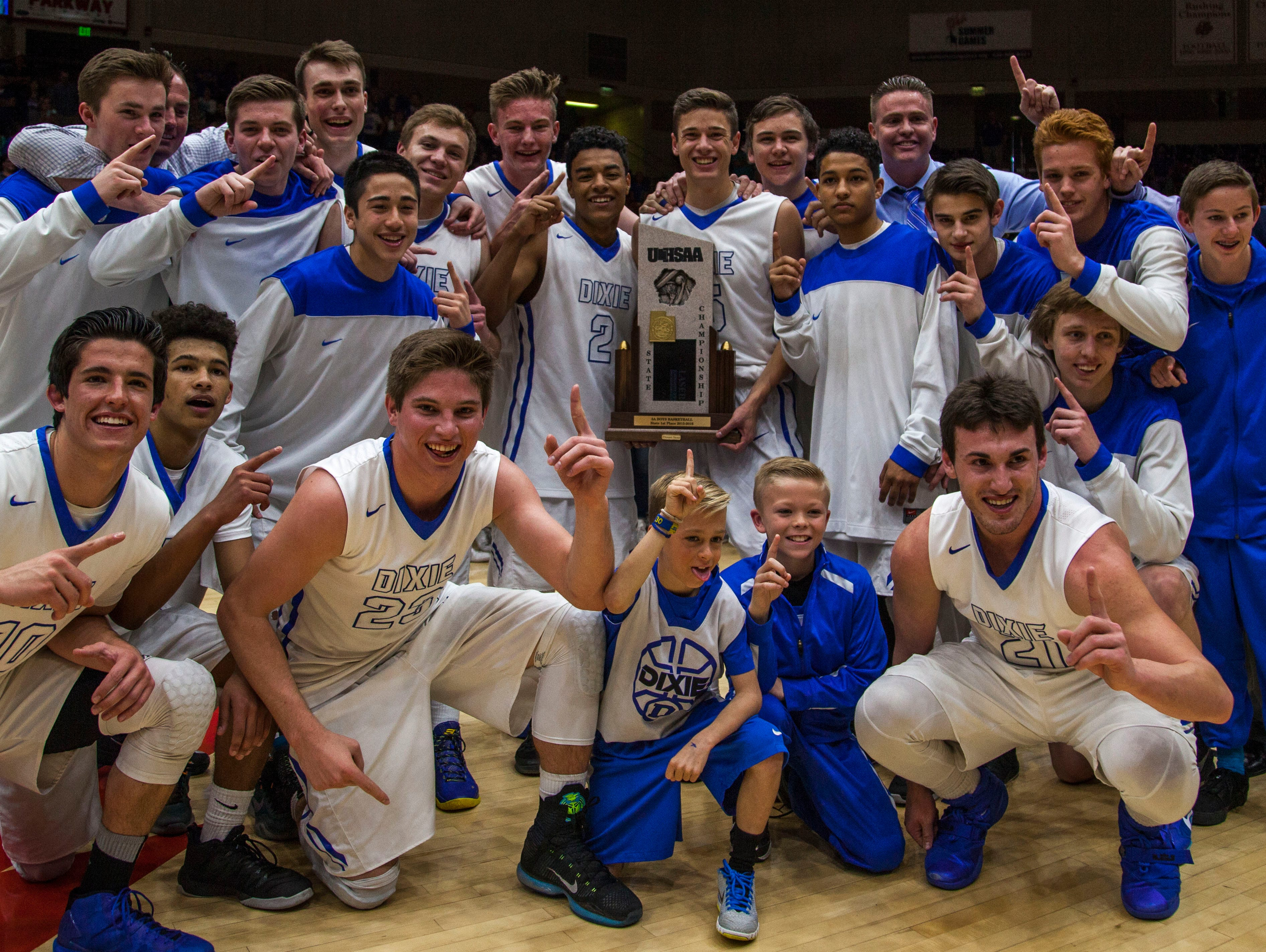 Dixie poses for a photo with the 3A championship trophy after defeating Juan Diego 65-57, Feb. 27, 2016.