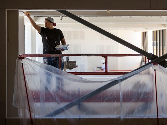 Construction crews work on changes to the Sharwan Smith Student Center at Southern Utah University, July 14, 2016.