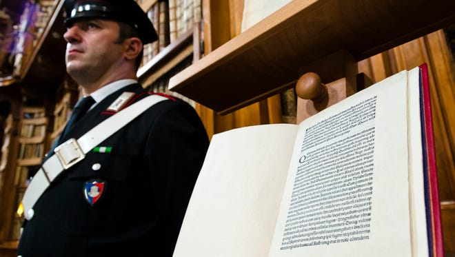 A reprinted copy of Christopher Columbus original letter written in 1493 about the discovery of the New World is displayed during a press conference in Rome, Wednesday, May 18, 2016. The United States has returned to Italy a letter written by Christopher Columbus in 1493 about his discovery of the New World that was stolen from a Florence library and unwittingly acquired by the Library of Congress.
