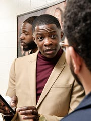 """James Shaw Jr., 29, talks with his best friend Brennan """"BJ""""McMurry after church. The two have been up all night after Shaw disarmed a shooter inside an Antioch Waffle House.  Sunday April 22, 2018, in Nashville, Tenn"""