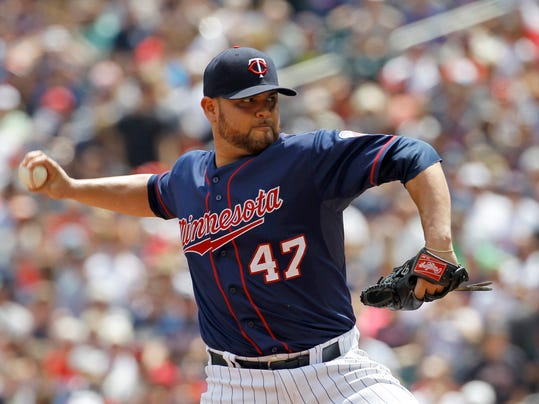 Minnesota Twins starting pitcher Ricky Nolasco delivers to the New York Yankees during the second inning of a baseball game in Minneapolis, Sunday, July 6, 2014. (AP Photo/Ann Heisenfelt)