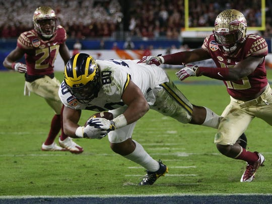 Michigan fullback Khalid Hill dives for a touchdown against Florida State during the second half of U-M's 33-32 loss in the Orange Bowl, Dec. 30, 2016 in Miami Gardens, Fla.
