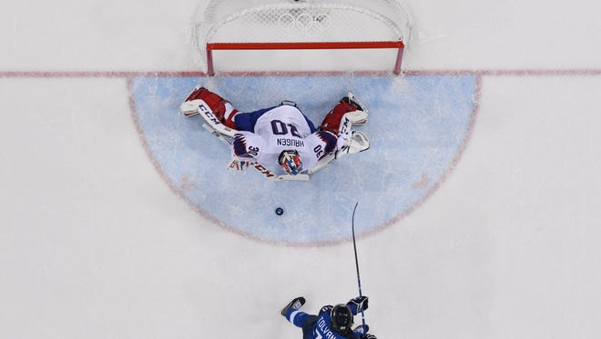 Finland forward Eeli Tolvanen scores a breakaway goal against Norway goalie Lars Haugen in Finland's 5-1 win Friday at Gangneung Hockey Centre. Tolvanen, the Nashville Predators' 2017 first-round pick, is one of the stars of the tourney so far and could be signed to help the Preds in the postseason. Andrew Nelles/The Tennessean