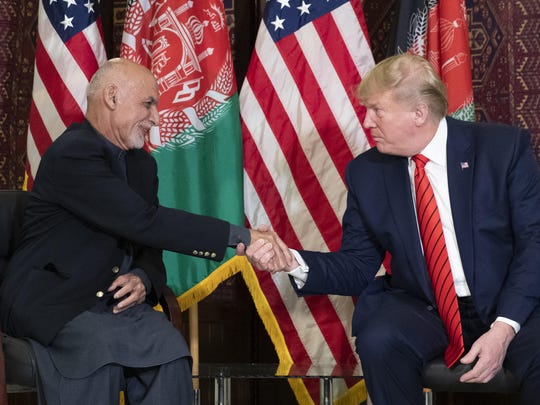 President Donald Trump shakes hands during a meeting with Afghan President Ashraf Ghani during a surprise Thanksgiving Day visit, Thursday, Nov. 28, 2019, at Bagram Air Field, Afghanistan. (AP Photo/Alex Brandon)