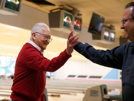 Sammy Manuele, 99, is congratulated by Asbury Park Press reporter Jerry Carino after a good frame at the Playdrome Bowling Alley in Toms River