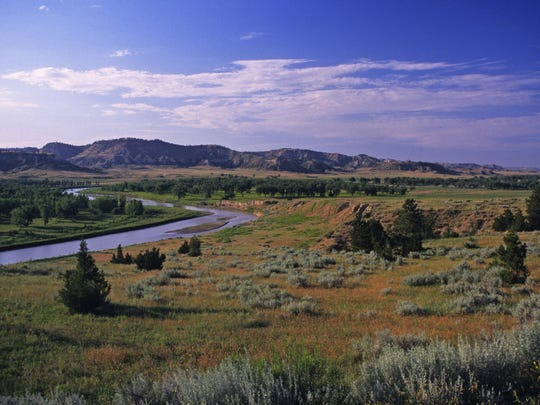 """""""A mile wide, too thin to plow, too thick too drink"""" – the Powder River south of Broadus."""