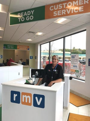Situated in front of an RMV entrance is a customer service help desk, manned by a staffer who will assist visitors to the registry in figuring out what they need to do and where they need to go. Some services are now offered online.