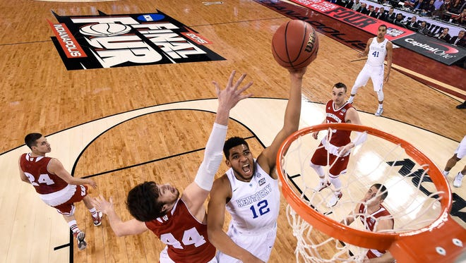 FILE - In this April 4, 2015, file photo, Kentucky's Karl-Anthony Towns (12) drives to the basket past Wisconsin's Frank Kaminsky (44) during the first half of the NCAA Final Four national semifinal college basketball game in Indianapolis. Small ball was the story of the NBA Finals. It might seem temporarily forgotten at the start of the NBA draft. The first three players taken Thursday, June 25, 2015, could easily be a trio of big guys, led by Kentucky's Karl-Anthony Towns.