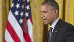President Obama speaks during a bill signing ceremony