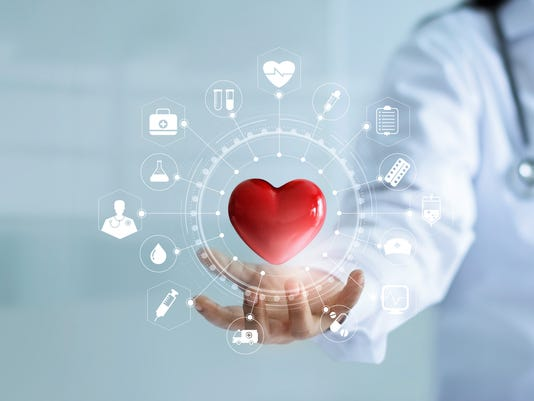 Medicine doctor holding red heart shape in hand with medical icon network connection modern virtual screen interface, service mind and medical technology network concept