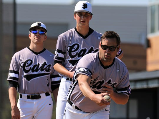 Plymouth pitchers David Zylka (7) and Dylan Brown watch