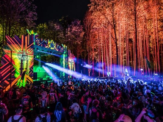 Fans watch a set at Michigan's Electric Forest festival