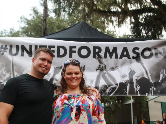 Zack White and his wife, Spring Rhinehart, pose for a photo Saturday. Their son Mason was killed by his paternal grandmother at the family's Killearn Lakes home last August.