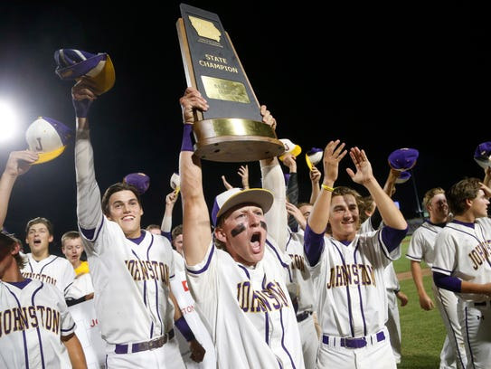 Johnston players celebrate their win over Dowling Saturday,