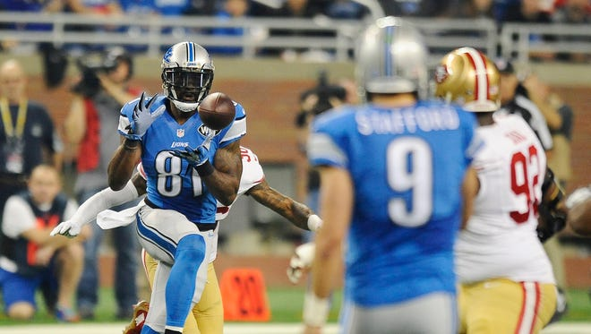 Calvin Johnson makes a reception in the first quarter on a pass from Matthew Stafford.