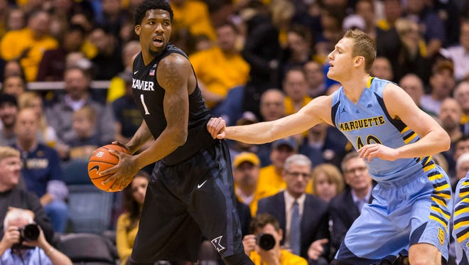 Xavier Musketeers forward Jalen Reynolds (1) holds the ball away from Marquette Golden Eagles center Luke Fischer (40) during the first half at BMO Harris Bradley Center.
