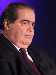 Supreme Court Justice Antonin Scalia waits for the