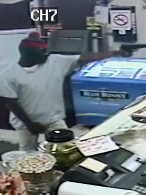 Police released this surveillance photo of a suspect in Thursday's armed robbery.