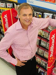 Charlie Anderson, CEO of Anderson Media and a University of Tennessee trustee, was photographed at Walmart's entertainment section, which his company supplies in every Walmart and Sam's Club store in United States and Canada.