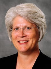 Jane Meyer's lawsuit against the University of Iowa began Monday in Des Moines with the selection of an eight-member jury and opening statements.