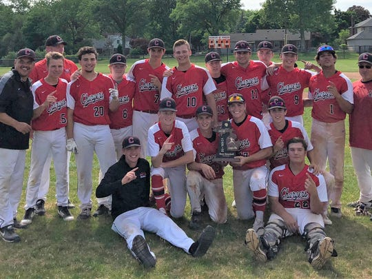 Livonia Churchill brought home the district baseball trophy after beating Livonia Franklin and Garden City.
