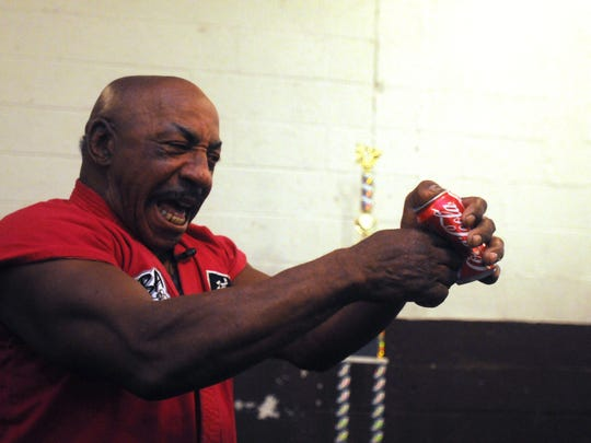 In this file photograph from Dec. 16, 2008 Grand Master Elton Trower stabs his index finger through an empty Coke can. Trower, a world champion breaker, is internationally known for poking his index finger through empty and full soda cans among other feats. Trower said poking a hole in a soda can is a lot harder than it looks and requires a great deal of speed an precision or else the can will just bend.