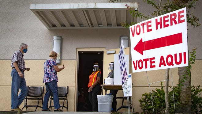 Voters arrive at the Wellington branch library for early voting, which contineus through Sunday at 18 locations before the Aug. 18 primary. Vote-by-mail ballots can be dropped off at the county's early voting sites.