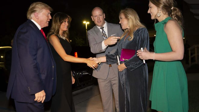 WEST PALM BEACH -- President Donald Trump and first lady Melania Trump are greeted by Family Church lead Pastor Jimmy Scroggins, his wife Kristin, and daughter-in-law, Reilly Scroggins as they arrive for a 6:30 pm Christmas Eve service.