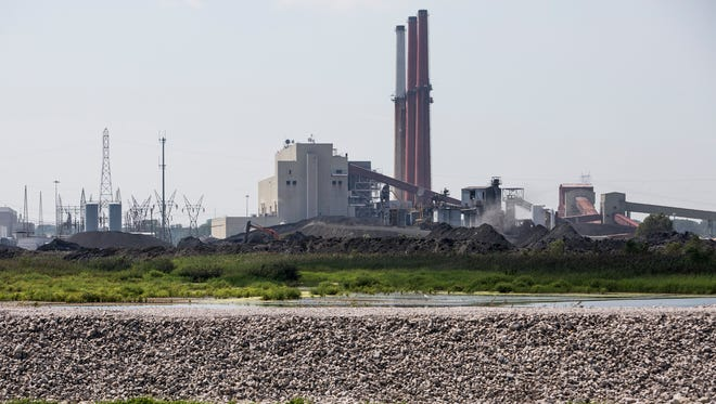 The Allen Fossil Plant is seen over coal ash containment ponds.