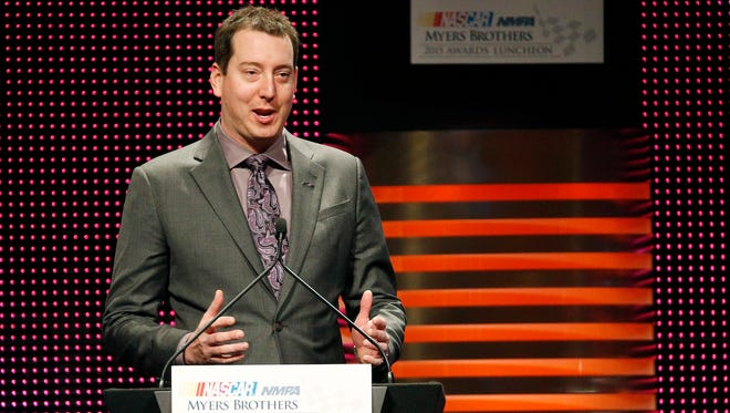 Kyle Busch speaks after winning the Goodyear NASCAR Series Champion Award during the NASCAR NMPA Myers Brothers Awards Luncheon.