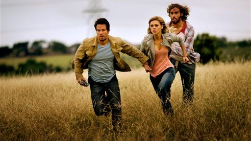 """Mark Wahlberg, left, Nicola Peltz and T.J. Miller star in """"Transformers: Age of Extinction."""""""