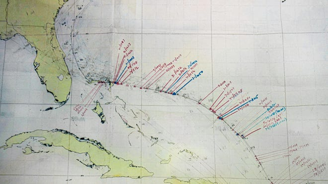 A photo of the hand-drawn plot of Hurricane Dorian, taken on Sept 2, 2019 when the center of the storm was over the northern Bahamas. Photo credit; Dennis Feltgen -  NOAA/NHC Communications