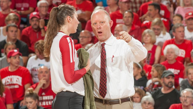 University of Wisconsin volleyball coach Kelly Sheffield confers with Lauren Carlini during a match against Ohio State Sept. 23 at the UW Field House in Madison.