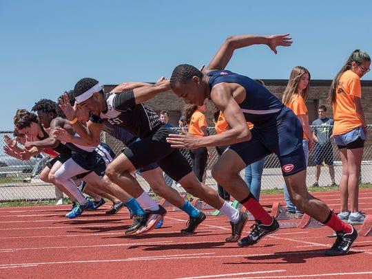 Participants in the 100-meter dash preliminary heat