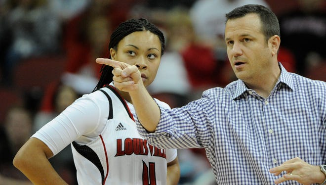 Louisville Cardinals head coach Jeff Walz (C) talks to forward Mariya Moore (4) and guard Jude Schimmel (22) during a game this past season.