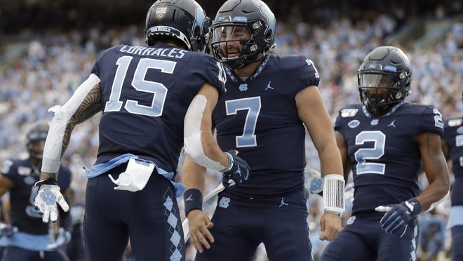 The play of quarterback Sam Howell, along with receivers Beau Corrales, left, and Dyami Brown, right, could have North Carolina flying high this season.