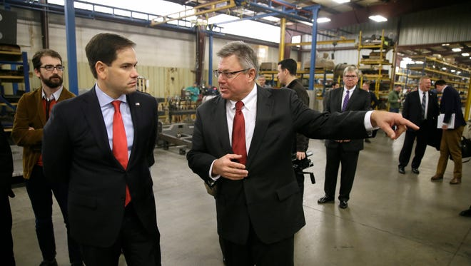 Republican presidential candidate Sen. Marco Rubio, R-Fla., talks with Weiler Manufacturing CEO Pat Weiler, right, during a plant tour, Thursday, Dec. 17, 2015, in Knoxville.