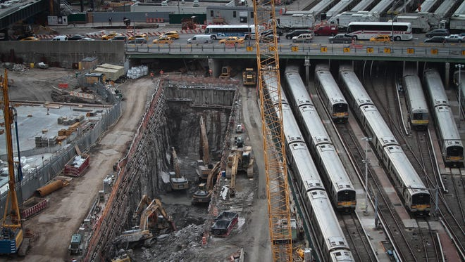 This April 17, 2014 file photo shows ongoing construction of a rail tunnel, left, at the Hudson Yards redevelopment site on Manhattan's west side in New York.