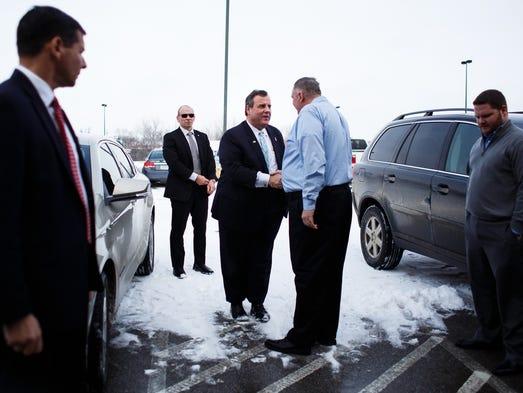 Republican presidential candidate Chris Christie greets