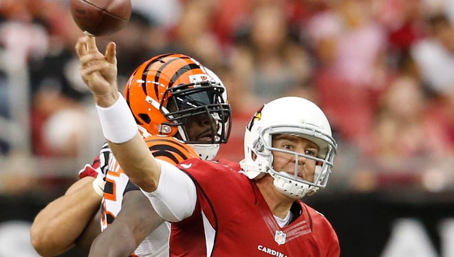 Cardinals quarterback Carson Palmer throws during the first quarter of a preseason game against the Bengals at University of Phoenix Stadium in Glendale on Aug. 24, 2014.